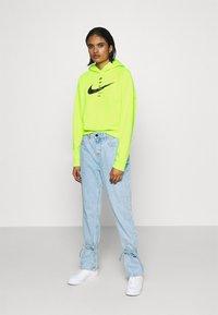 Nike Sportswear - HOODIE - Hoodie - volt/black - 1