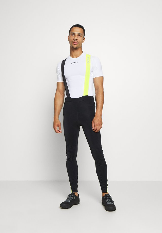 C5 THERMO TRÄGERHOSE - Leggings - black/neon yellow