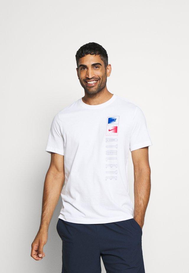 TEE TEAM - T-shirt med print - white