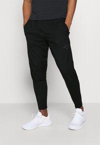Nike Performance - Pantalon de survêtement - black - 0