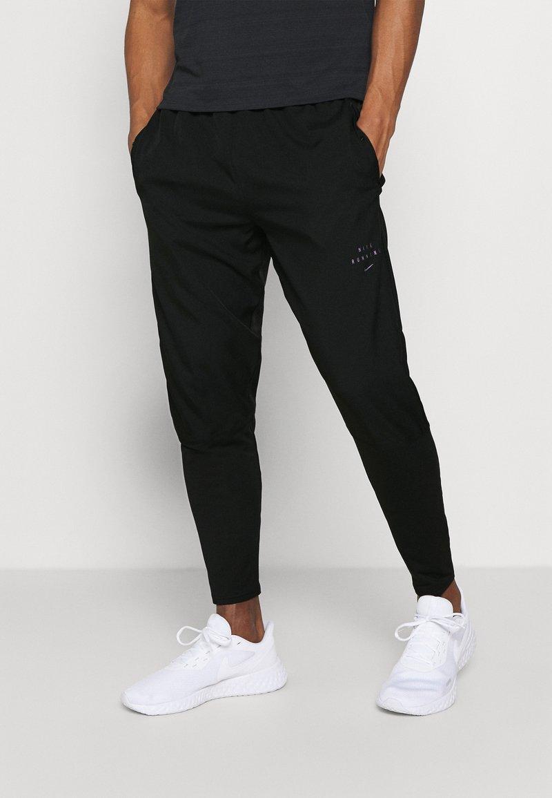 Nike Performance - Tracksuit bottoms - black