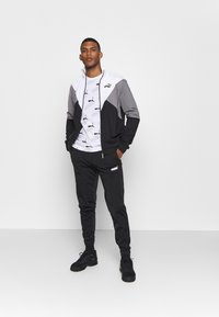 Puma - RETRO TRACK SUIT - Survêtement - black - 1