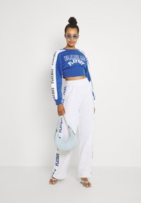 Missguided - PLAYBOY SPORTS WIDE LEG - Tracksuit bottoms - grey marl - 1