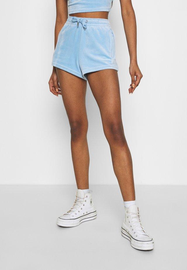 TAMIA TRACK - Shorts - powder blue