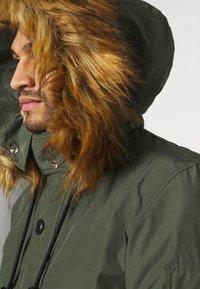 Diesel - W-JAME JACKET - Winter jacket - olive - 4