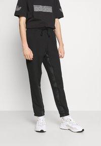 adidas Originals - R.Y.V. SWEATPNT ORIGINALS PANTS - Tracksuit bottoms - black - 0