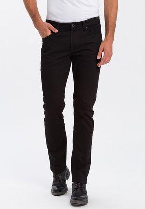 DYLAN - Straight leg jeans - black