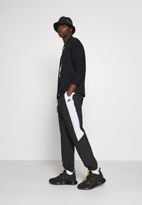 Nike Sportswear - Träningsjacka - black - 1
