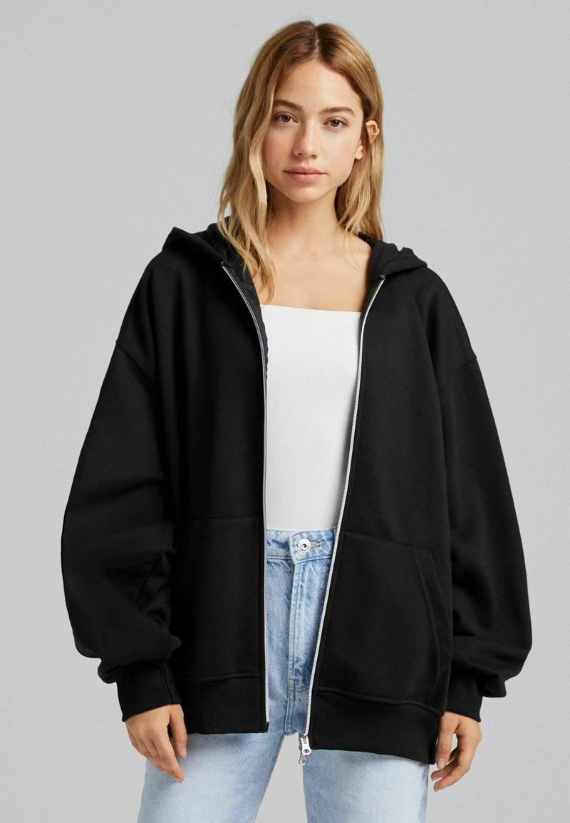 Bershka - OVERSIZE - Zip-up sweatshirt - black