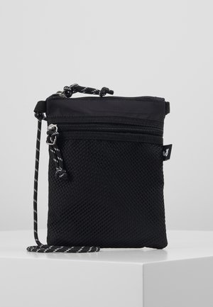JACRIBSTOP SLINGBAG - Across body bag - black