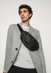 ARKK Copenhagen - BUM BAG - Bum bag - black - 0