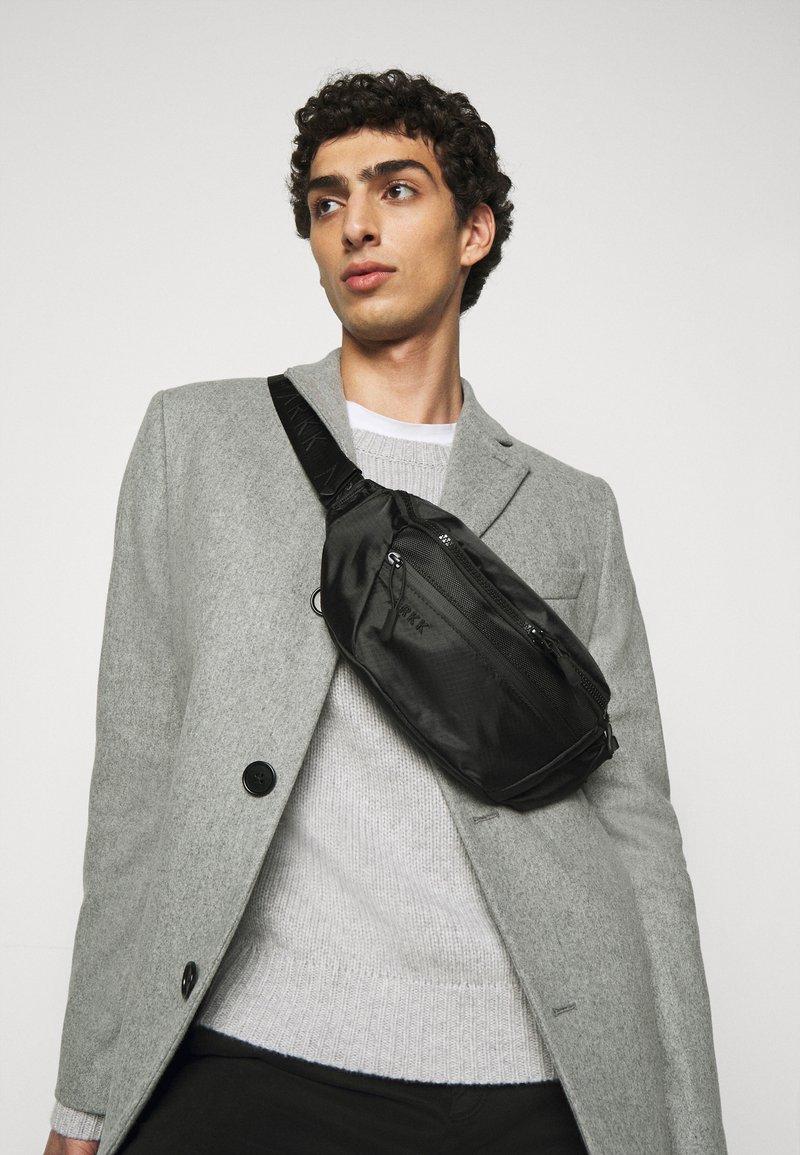 ARKK Copenhagen - BUM BAG - Bum bag - black