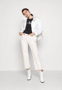 Calvin Klein Jeans - MONOGRAM STRETCH SPORTY TANK - Top - black - 1