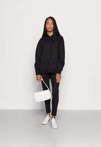 Calvin Klein Jeans - BACK BLOWN UP LOGO HOODIE - Mikina skapucí - black - 1