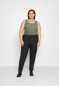 Nike Sportswear - AIR - Leggings - Trousers - black - 1