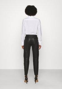 Belstaff - FREYA TROUSER - Leather trousers - black - 2