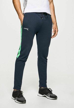 AMR RACER - Tracksuit bottoms - navy/green