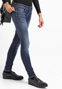Replay - HYPERFLEX LUZ - Jeans Skinny Fit - dark blue - 3
