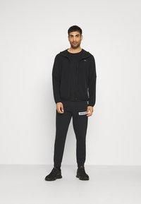 Calvin Klein Performance - PANT - Teplákové kalhoty - black - 1