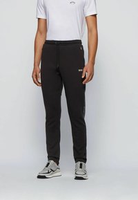 BOSS - Tracksuit bottoms - black - 0