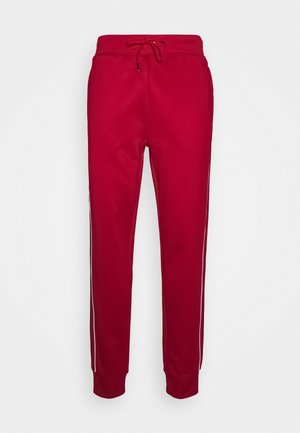 LUX TRACK - Tracksuit bottoms - red