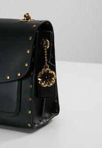 Coach - PARKER SHOULDER BAG - Across body bag - black - 6