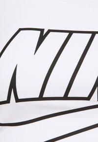 Nike Performance - FUTURA BRA - Medium support sports bra - white/black - 6