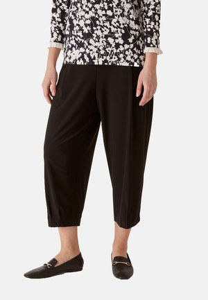 SLOUCHY - Trousers - nero
