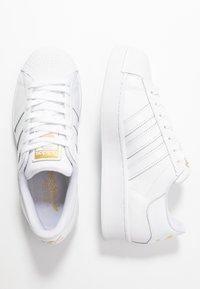 adidas Originals - SUPERSTAR BOLD - Trainers - footwear white/gold metallic - 5