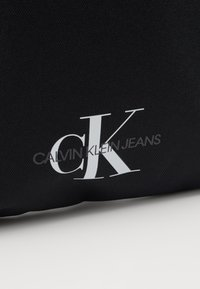 Calvin Klein Jeans - FLATPACK - Across body bag - black - 2