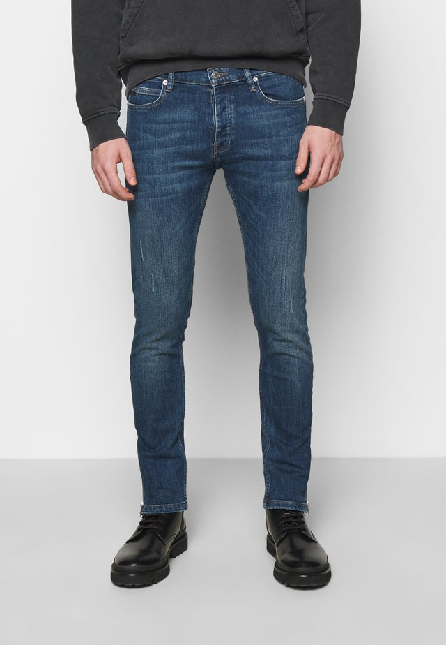 WITH ZIPPER DETAIL ON THE BOTTOM - Jeans Slim Fit - blue