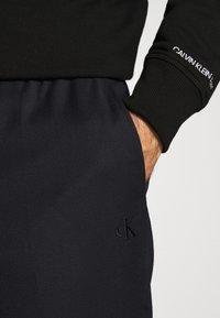 Calvin Klein Jeans - GALFOS - Spodnie materiałowe - black - 6