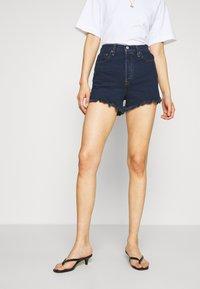 Levi's® - RIBCAGE - Shorts di jeans - charleston blue black - 0