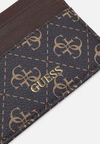 Guess - VEZZOLA CARD CASE UNISEX - Wallet - dark brown - 4
