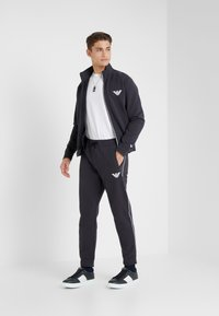 Emporio Armani - TROUSERS - Tracksuit bottoms - navy blue - 1