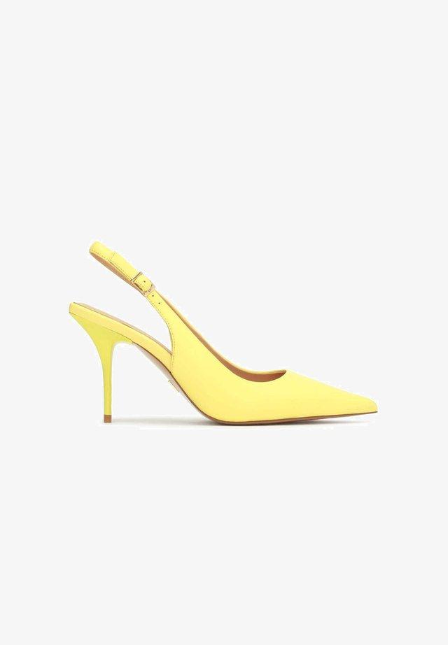 Højhælede pumps - yellow