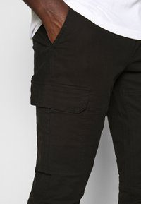 Topman - CARGO TROUSER - Cargo trousers - black - 4