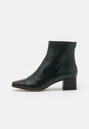 CAMILIA - Classic ankle boots - foret