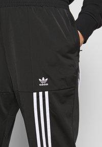 adidas Originals - CATHARI - Tracksuit bottoms - black - 7
