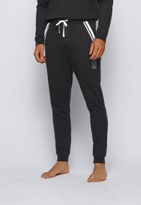 BOSS - AUTHENTIC - Tracksuit bottoms - black - 0