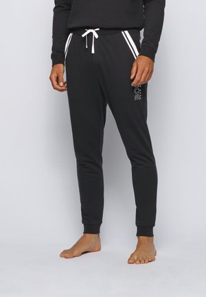 AUTHENTIC - Tracksuit bottoms - black