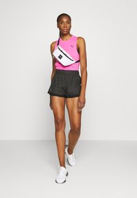 Puma - TRAIN PANEL TANK - Sports shirt - luminous pink - 1