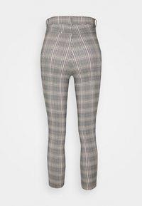 Vero Moda Petite - VMAUGUSTA CHECK - Trousers - black/white/yellow - 1