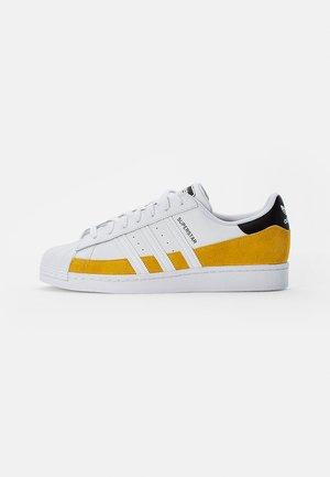 SUPERSTAR - Trainers - hazy yellow/ white/core black