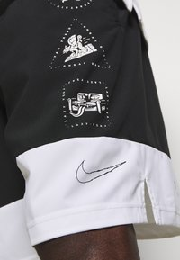 Nike Performance - SHORT - Träningsshorts - black - 4