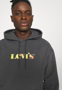Levi's® - RELAXED GRAPHIC  - Felpa con cappuccio - black - 4