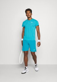 Nike Performance - FLX ACE - Pantalón corto de deporte - neo turquoise/white - 1