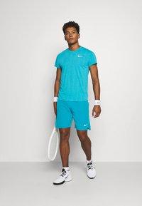 Nike Performance - FLX ACE - Sports shorts - neo turquoise/white - 1