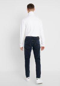 Nudie Jeans - TIGHT TERRY - Džíny Slim Fit - black ocean - 2