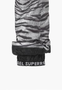 SuperRebel - SUSTAINABLE UNISEX - Snow pants - white - 4